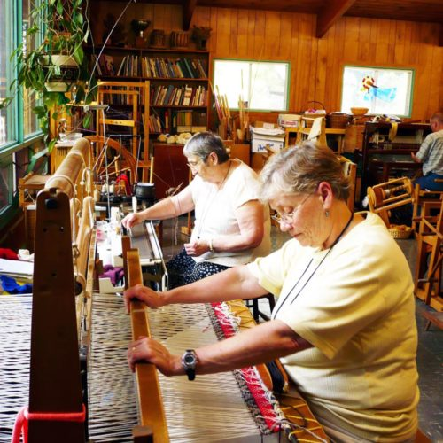 Mary McGoff and Laurette Patenaude weaving and knitting