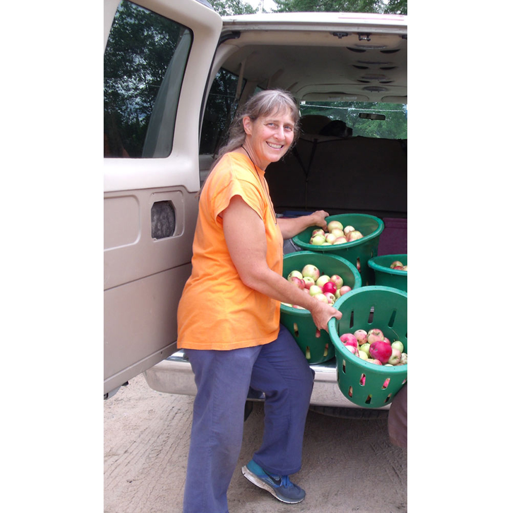 Ruth loading apple baskets into the van
