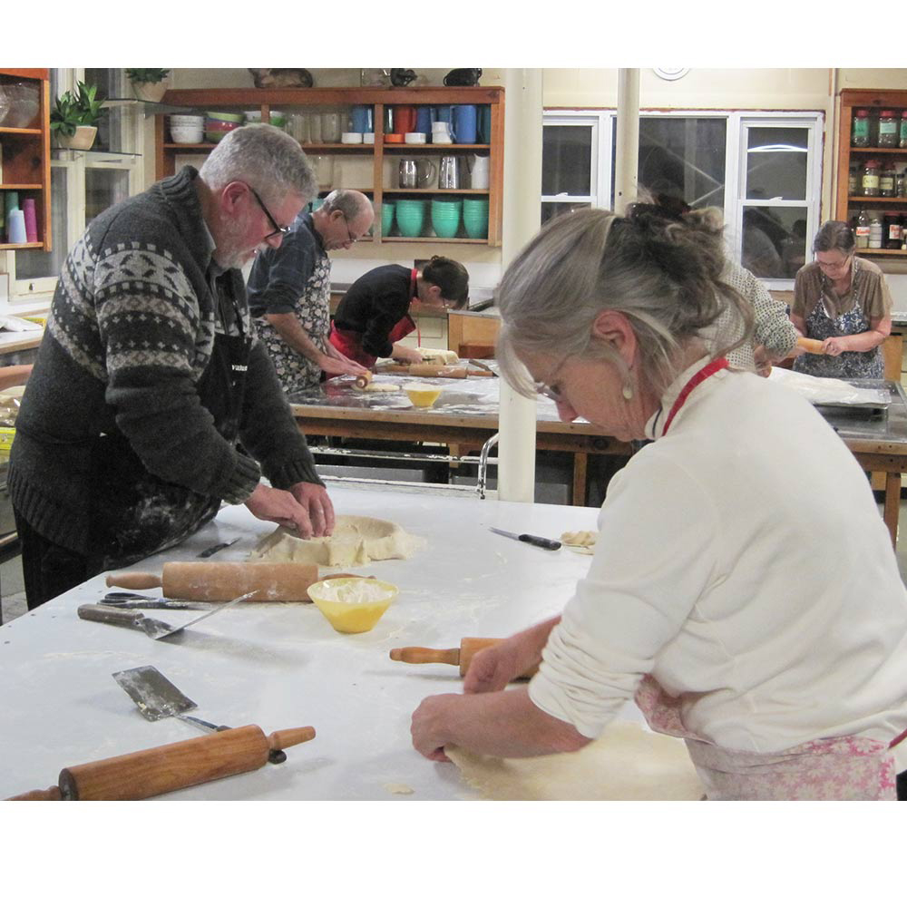 Fr Phil Thibodeau and Elizabeth Bassarear roll out dough for tortiere crusts